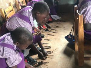 Children learning with sticks   Elwa Sunrise   Uganda, Africa   To Know God and Prosper